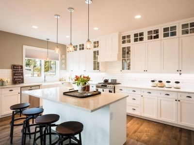 White Ceiling Height Cabinets With Dark Hardware Custom Infill In