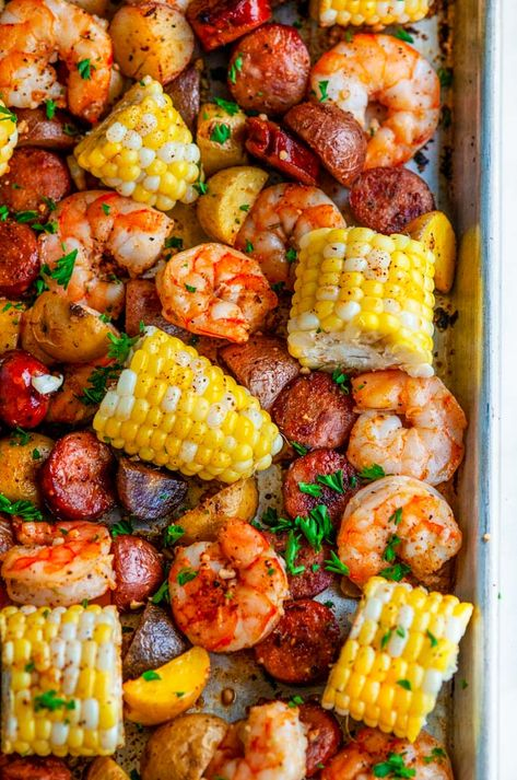 Sheet Pan Shrimp Boil - All the flavors of a classic shrimp boil without the mess Creole seasoned juicy shrimp andouille sausage potatoes and tender corn From sheet pan shrimp boil southern neworleans creole cajun recipe dinner onepot Seafood Boil Recipes, Seafood Dishes, Fish Recipes, Chicken Recipes, Corn Recipes, Seafood Bake, Shrimp Boil Recipes, Shrimp Boil Seasoning Recipe, Shrimp Boil Recipe Old Bay