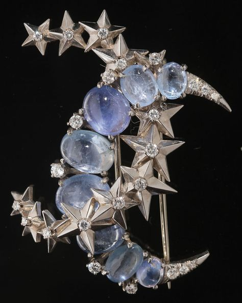 "VERDURA PLATINUM, MOONSTONE AND DIAMONDS ""CRESCENT MOON AND STAR"" BROOCH, 20TH CENTURY. Containing eight bluish tone moonstones or labradorites set in a crescent form, accented with brilliant cut diamonds overlapping a crescent form of 13 graduating five-point stars each centered with a prong set diamond."