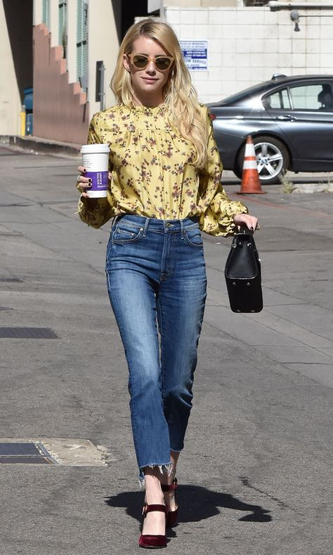 Emma Roberts opted for a bohemian-inspired look in a yellow floral-printed blouse by Wilfred for Aritzia. It featured modest long sleeves and a ruffled neck and cuffs. She tucked the vintage-romantic silk top into a pair of Mother frayed cropped jeans.