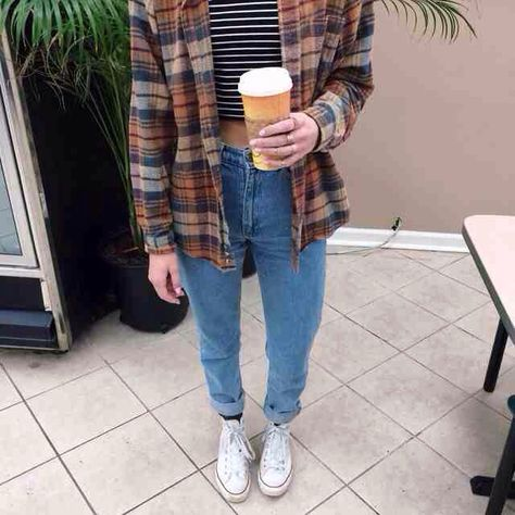 Plaid is in this fall and winter! White chucks /converse are perfect with just about any type of jeans! High waisted light colored jeans And a striped crop top ties the outfit all together! In fact I have this whole outfit myself and I love it! Fall outfit!