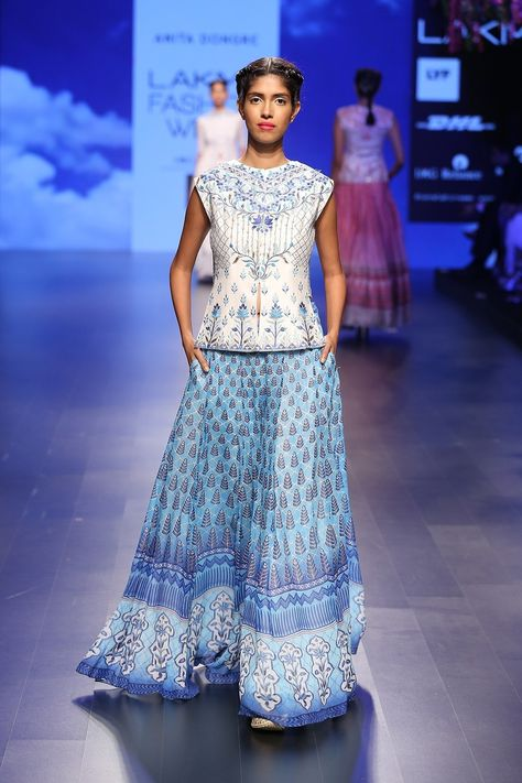 Anita Dongre, coveted for bridal couture, handcrafted luxury pret and menswear, derives inspiration from the splendid crafts of Rajasthan and remote villages of India. The top Indian designer's collections online now.