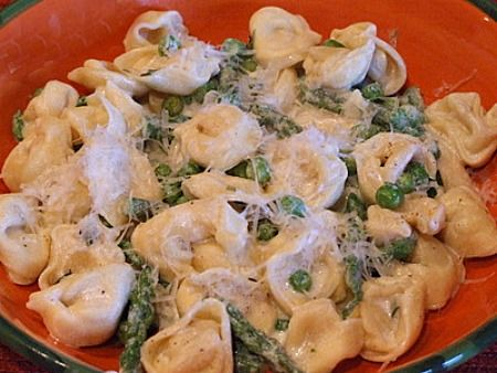 A creamy tortellini pasta recipe with peas and asparagus in a fresh tarragon- flavored sauce.