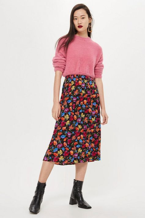 Channel an ultra-feminine look with our stylish pleated midi skirt in multicolour. We're wearing this versatile design for day or night.