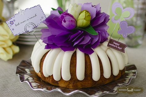 """With this bundt cake at the center of a Mother's Day celebration, she's sure to know she's the """"Best Mom A'Round'""""!   Nothing Bundt Cakes"""