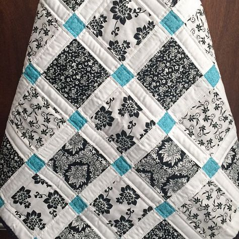 Modern black, white and teal quilt.