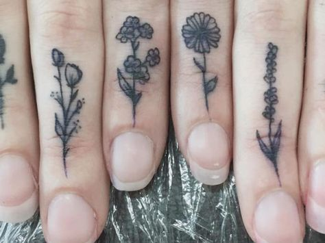 These Tiny Floral Tattoos Make Up A Flower Garden On This Girl S Hand And We Re So In Awe Neck Tattoo Floral Tattoo Tattoos