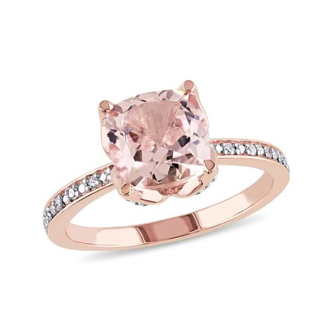 Make all her dreams of your proposal real as you slip this gemstone engagement ring onto her waiting finger. Fashioned in precious 10K rose gold, this impressive design highlights an 8.0mm cushion-cut soft-pink morganite nestled in a lovely floral-inspired setting touched by sparkling diamond accents. Petite diamond accents line the ring's slender tapered shank, creating a look beyond all compare. Buffed to a brilliant luster, this engagement ring is destined to delight.