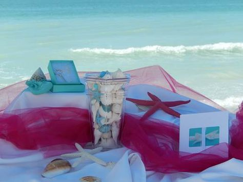 """.To participate in our contest, create your own Pin board titled """"#seashellsweddingbells"""", fill the board with your dream beach wedding ideas and include one of our logos on the board. The winner is the person with the most followers. There will be 3 winners. 1st Prize: 2 night stay at Tortuga, Tradewinds, Seaside or Tropic Isle inn, champagne on arrival, $50 gift certificate for the Le Petite café. 2nd Prize: Tiffany key necklace with silver chain. 3rd prize: $100 Tiffany gift card."""
