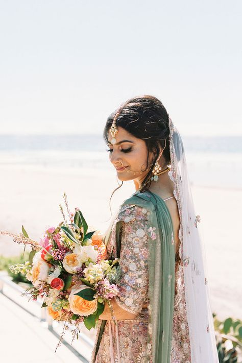 From the editorial A Colorful San Diego Wedding Day With Jaw-Dropping Ocean Views. This wedding's fashion? Absolutely SPECTACULAR to say the least. 😍 We're beyond excited to share every little detail on SMP, along with the full gallery captured by @arielminphoto!! #weddingfashion #bridefashion #indianwedding #bridesari #beachbride #weddingdress #brideinspiration