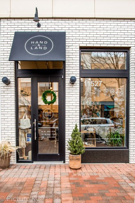The Most Beautiful Independent Store in Every State in America The faade of Kansas jewel Hand Land is coated a white brick that calls to the white tile interiors. Building Front, Building Exterior, Brick Building, White Building, Cafe Exterior, Boutique Store Front, Boutique Stores, Boutique Store Design, Small Coffee Shop