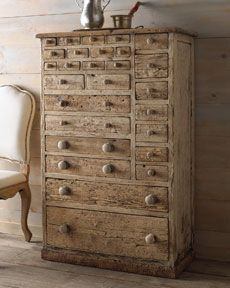 weathered--and I like the asymmetrical drawers