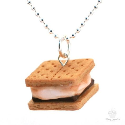 Sitting by the campfire toasting marshmallows will never be the same again! Treat yourself to the adorable Scented Smores Necklace by Tiny Hands and be the envy of your camping friends.