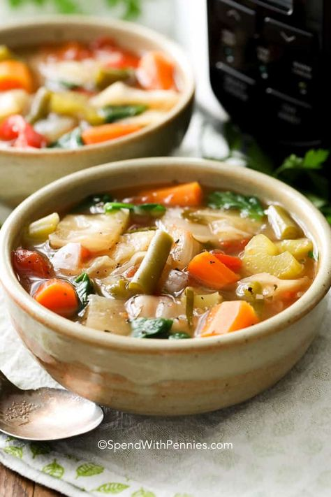This easy Slow Cooker Cabbage Soup recipe has fresh vegetables and cabbage all simmered in a delicious broth. It's naturally low in calories and fat and high in fiber. #spendwithpennies #cabbage #vegetablesoup #soup #easyrecipe #freezerfriendly