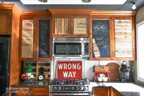 Donna, author of Funky Junk Interiors, wanted her kitchen cabinets to reflect her style without butchering the existing cabinets. These burlap, chalkboard and pallet panels are actually glued onto black corrugated plastic and affixed with two-sided carpet tape. Genius.