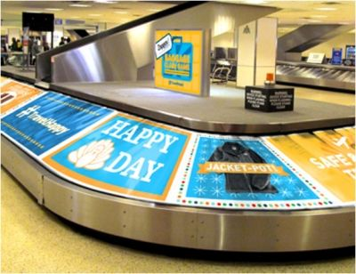 Zappos makes the baggage carousel at the Houston airport into a Wheel of Fortune-style game.  This is a sweet idea!