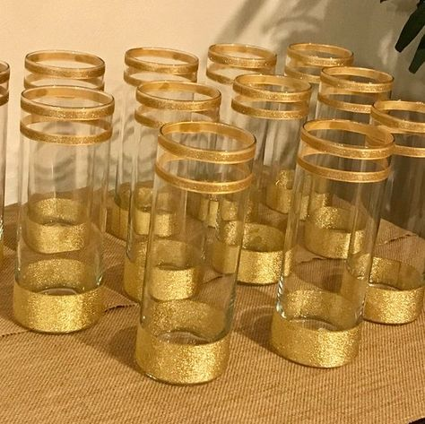 Set of 12 cylinder vases for 78 dollars. Decorated with gold shimmering ribbons, wedding Centerpieces, shower Centerpieces 50th Anniversary