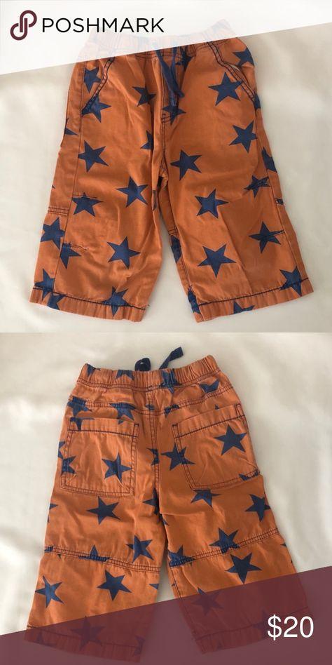 d0e179ac6ee0 Mini Boden Long Board Shorts EUC Size 8 Cute Mini Boden long Board Shorts.  Orange with navy stars. Elastic waist with drawstring. EUC. Size 8.