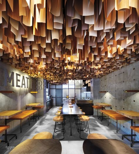Cool restaurant design by Yod Studio of Commercial Design. Timber veneer strips suspended at the ceiling.