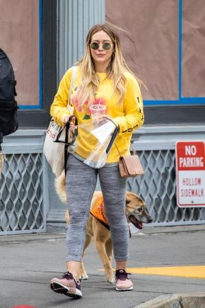 Hilary Duff wearing Nike Air Presto Sneakers, Chanel Chevron Boy Bag