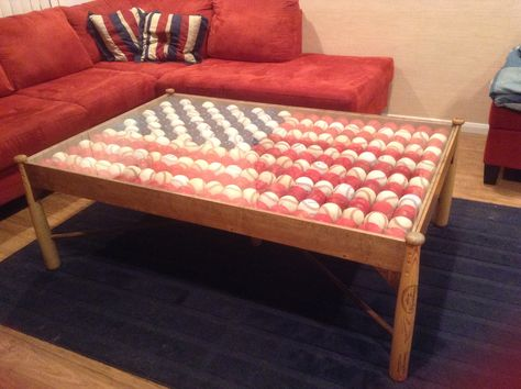 Brandan's Baseball American flag coffee table.  Made with baseball bats for the legs,  One of a kind