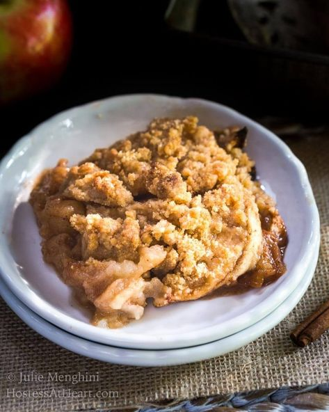 Quick and Easy Apple Crisp Recipe is loaded with sweet juicy apples in brown sugar and cinnamon sauce and topped with a delicate crunch. #applecrisp #appledessert #applerecipe #fallrecipe #hostessatheart HostessAtHeart.com