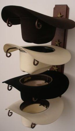 For closet - Amazon.com: Cowboy Hat Holder STAR: Storage & Organization Most of the cowboy hats now have a home!  I picked it up at the western store in Columbia mall.  Perfect for my men!!
