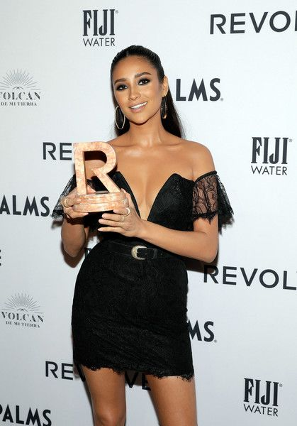 Shay Mitchell accepts an award during the 2018 #REVOLVEAWARDS.