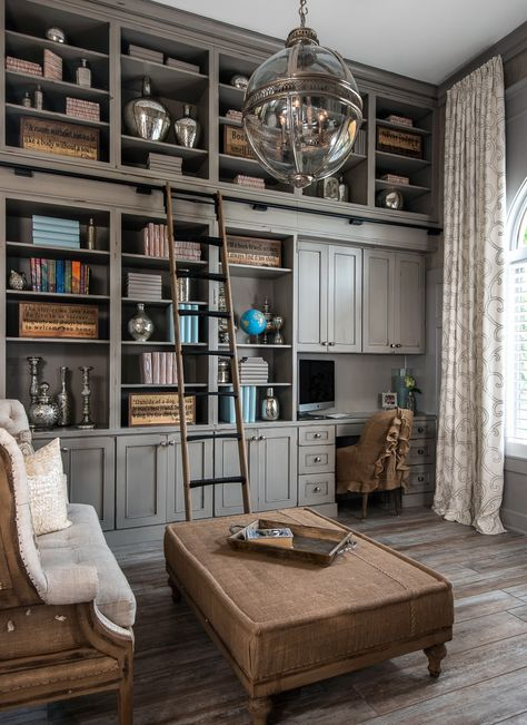 Dura Supreme cabinetry library in Heritage Paint. Gray home office and library with shabby Chic decor, rustic pray Heritage Paint shelving and distressed wood floors. Whole-Home Makeover! A multi-room makeover of this Michigan home called for the design expertise of Lindsey Markel at Dillman & Upton, Inc of Rochester, MI to bring together a stunning whole-home interior that blended purposeful functionality with cohesive architectural design… Read more on the Dura Supreme Blog