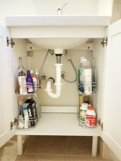 Use a shower caddy as storage shelving under a small sink