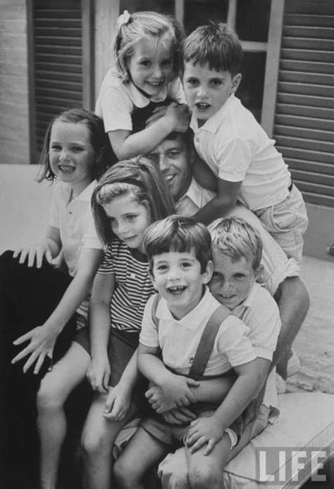 Robert Kennedy w. his niece Caroline sitting on his lap, (clockwise) his daughters Courtney & Kerry w. sons Michael & David who is holding his nephew John Jr. at Hickory Hill home, June 1964.