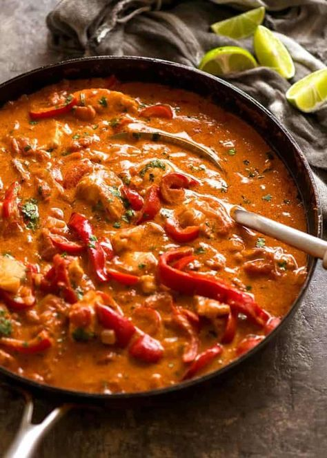 Brazilian Fish Stew in a black skillet, fresh off the stove, ready to be served