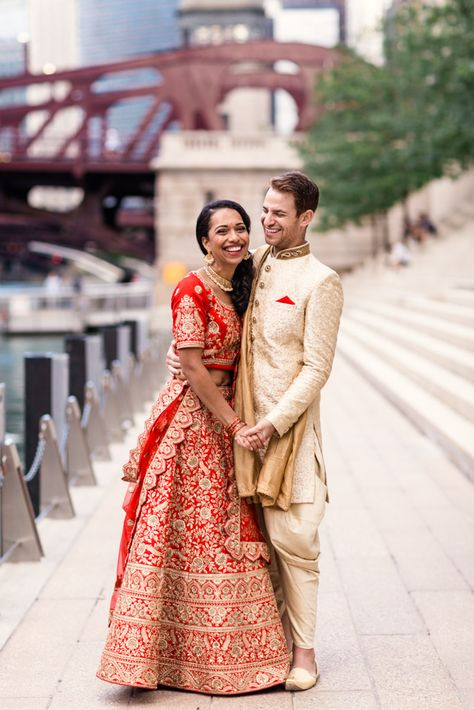 Candid photo of Chicago Indian bride and groom smiling at Riverwalk