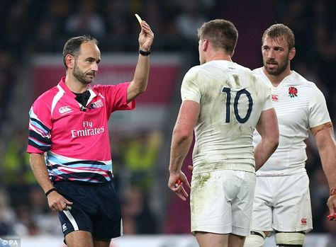 World Cup referee Romain Poite shows a yellow card to England's Owen Farrell during Saturday's loss
