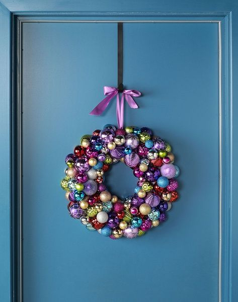 Accent a holiday wreath with Pantone's 2014 color of the year, radiant orchid! Get the how-to for this ornament wreath at BeadStyleMag.com.