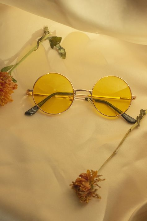 A thin metal rose gold frame in a medium circle shape lens with a yellow tint. Perfect for festival season, or making your darker days a little lighter.  UV400 protection Yellow tint lenses Rose gold tone frame  Colour:Yellow Tint