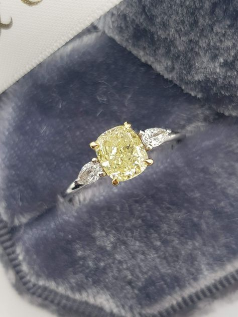 Carats Fancy Yellow Cushion Cut with 2 Pear Shape Side Stones Diamond Engagement Ring Yellow Stone Rings, Yellow Diamond Rings, Unique Diamond Rings, Yellow Diamonds, 3 Stone Diamond Ring, Canary Diamond, Black Diamond Jewelry, Yellow Diamond Engagement Ring, Luxury Engagement Rings