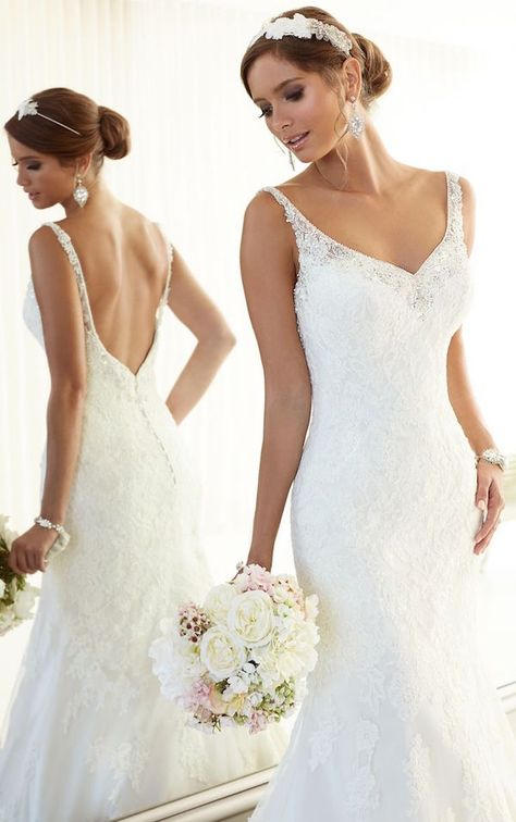 Beading and lace make the perfect wedding dress combo! Dress via Olivelli