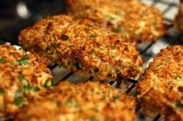 Pork chops dipped in ranch dressing and coated in Italian bread crumbs with Parmesan cheese and garlic.