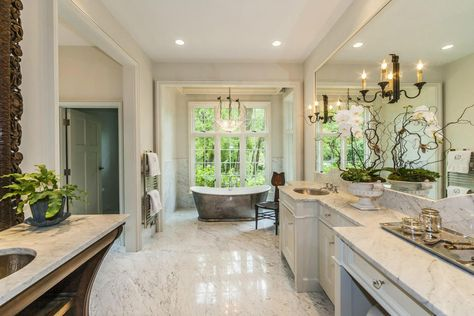 traditional master bathroom with flat panel cabinets