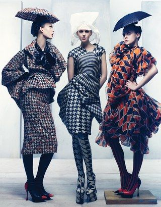 From left: Alexander McQueen's silk tweed jacket and skirt and polyester blouse, at Alexander McQueen, New York. Philip Treacy for Alexander McQueen hat