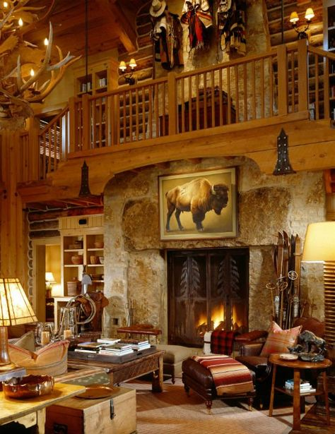 Terrific rustic mountain home. Love that huge and decorative fireplace screen! And, check out the decorative chaps and western hats on the second floor.