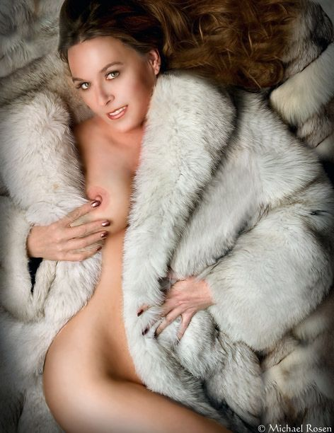 Sexy naked black woman in fur coat