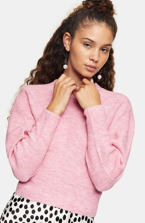 Slouchy drop-shoulder sleeves frame this cozy, cropped sweater that warms up your off-duty day.