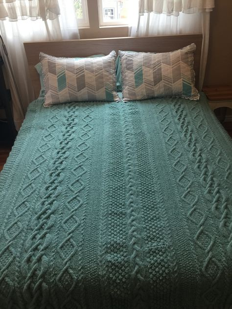 Knitting Pattern for Aran Heirloom Blanket - Cable afghan knit 5 sections and seamed. Finished Size: About 64″ (162.5 cm) wide and 68″ (173 cm) long. Designed byDeborah Newton. Pictured project byBSR123