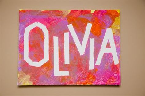 kid painted canvas over masking tape letters