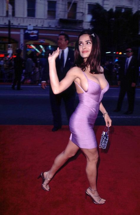 Salma Hayek gorgeous curves and sexy legs in figure hugging low cut body con purple mini dress and high heels.