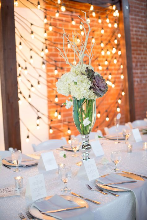 #headtable #wedding #reception #decor #tablescape #placesettings #white #gray #silver #brick #bistrolights #inspo #industrial #glam #venue #ALWE #andrealeslieweddings #Arizona #DowntownPhoenix Planning & Coordination:: Andrea Leslie Weddings & Events // Photo :: Ashley Rae Photography // Venue :: Warehouse 215 at Bentley Projects // Florals :: Butterfly Petals // Rentals :: Angelic Grove, La Tavola Fine Linen, & Classic Party Rentals // Stationary :: Rippke Design & Victoria York Design //