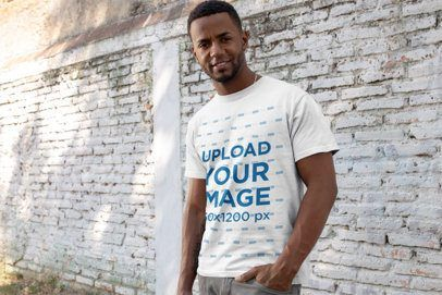 Download Placeit T Shirt Mockup Of A Fit Man In Front Of An Old Block Wall Shirt Mockup Mens Fitness Tshirt Mockup