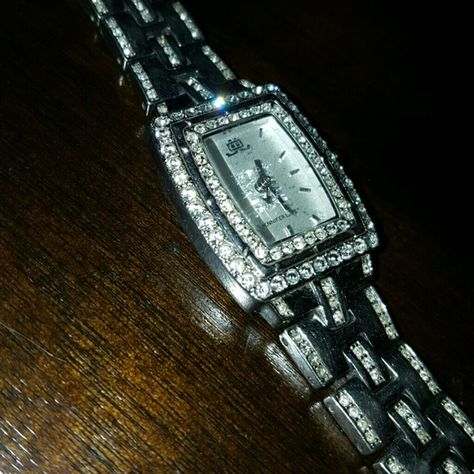 Jennifer Lopez J.LO WATCH Jennifer Lopez stainless steel back base metal bezel I just had the battery replaced.Rhinestone are intact it's a beautiful beautiful watch it has  rhinestones all over the face of the watch and on the armband as well very beautiful and classy watch Jennifer Lopez Accessories Watches